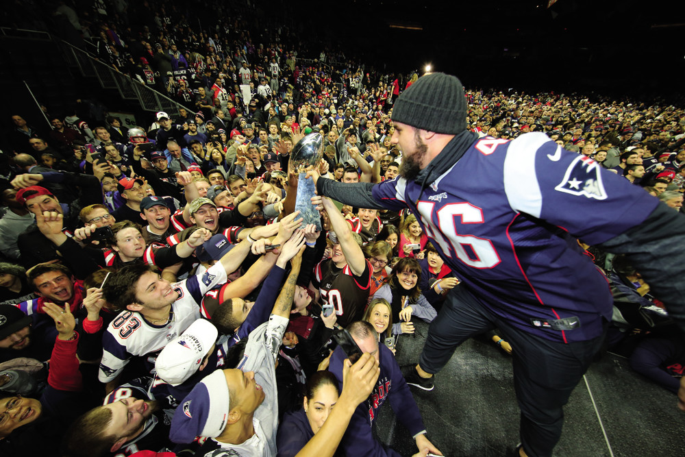 Patriots fullback and Brown University alum James Develin celebrated with fans at the Dunkin' Donuts Center last month after winning Super Bowl LI