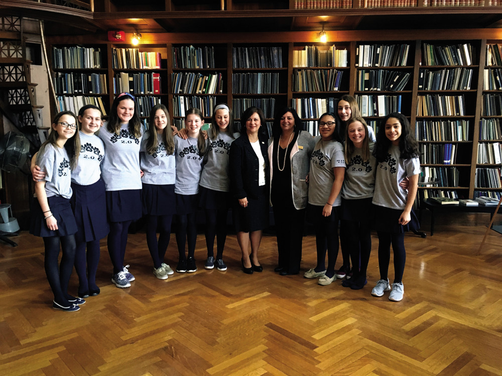 The Bay View Academy's robotics team, celebrating here with Secretary of State Nellie Gorbea, will go to the FIRST Lego League World Festival in St. Louis on April 26