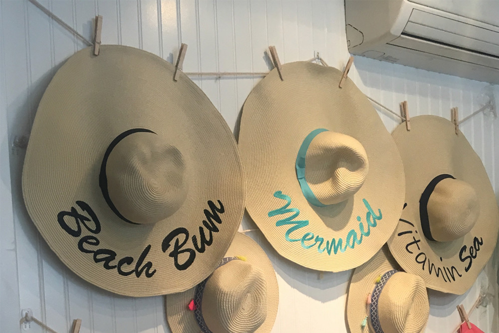 Funky beach hats from Pink Pineapple are a must this summer
