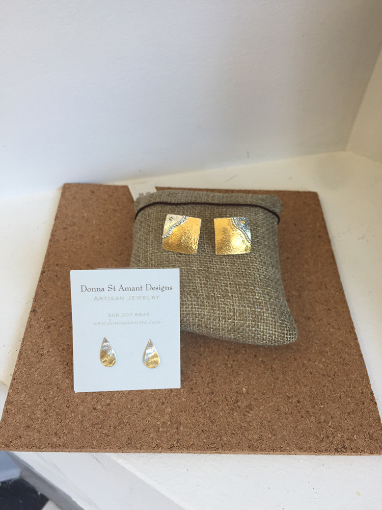Jewelry by Donna St. Amant: small earrings $76; larger square earrings $280