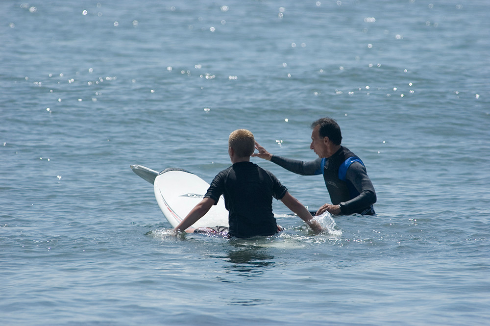 Pete Pan teaching a surf student