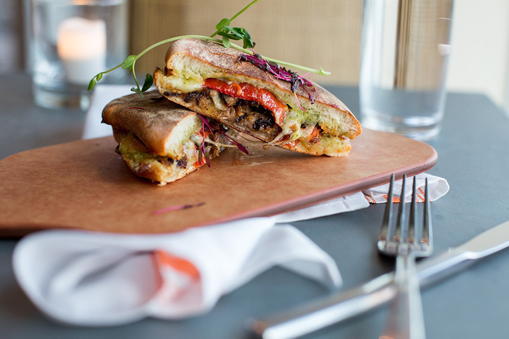 Portuguese bolo with braised pork, fontina, roasted cherry tomato and cilantro spread