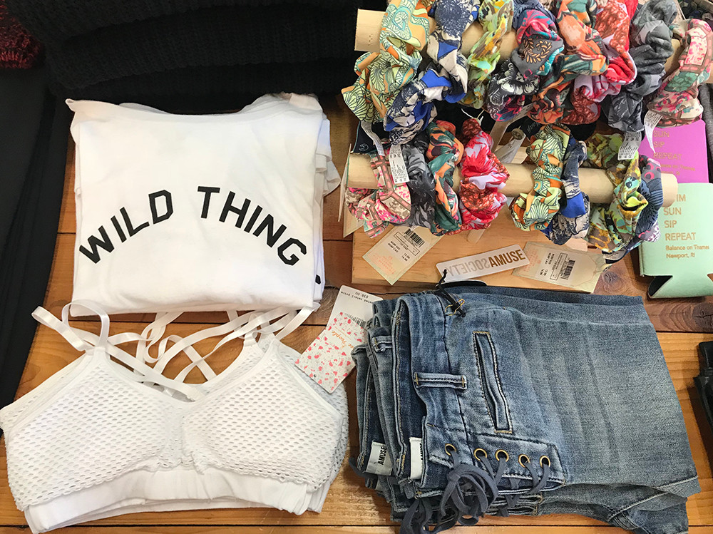 Hair accessories, $12; sweatshirt, $33; mesh sports bra, $38; jeans, $69.50