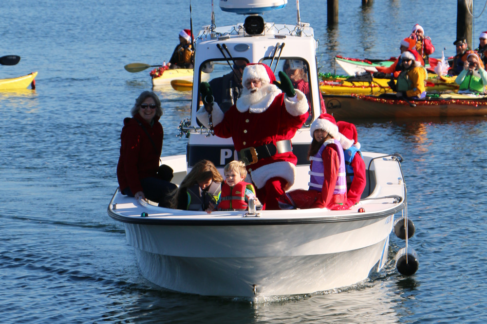 Santa arrives by boat in Wickford Harbor on December 1-3