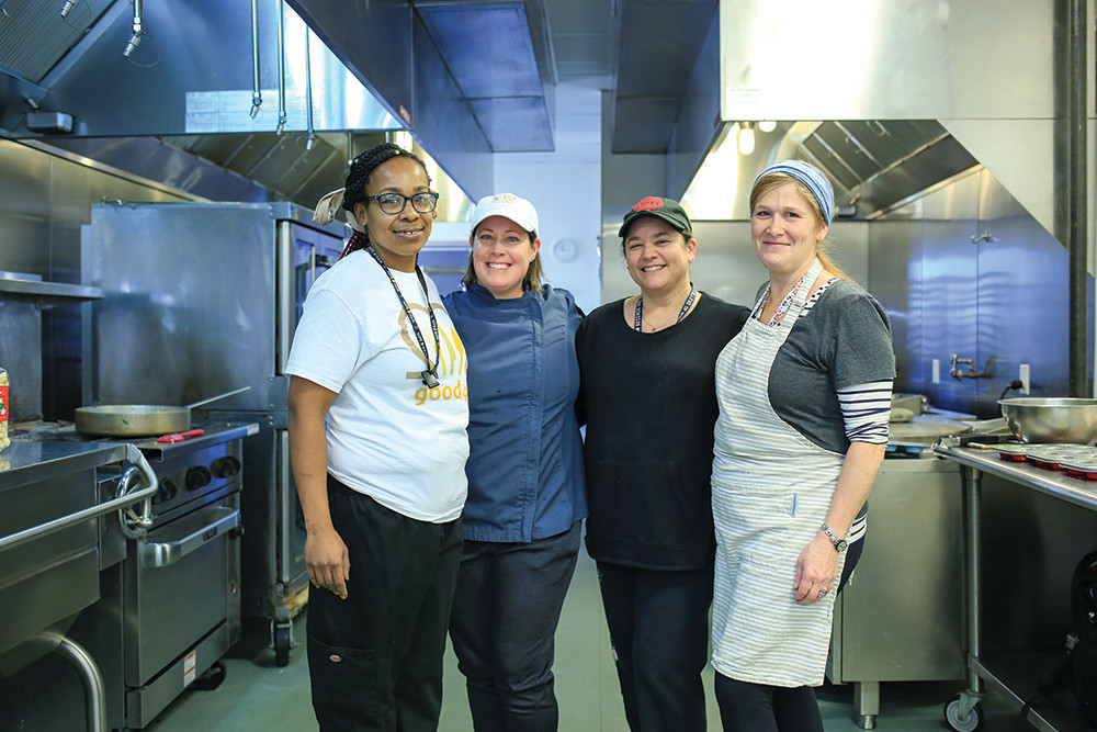 Business and life partners Cindie DeMello and Tanya DiMarco (center) combined forces to make meals with fitness in mind