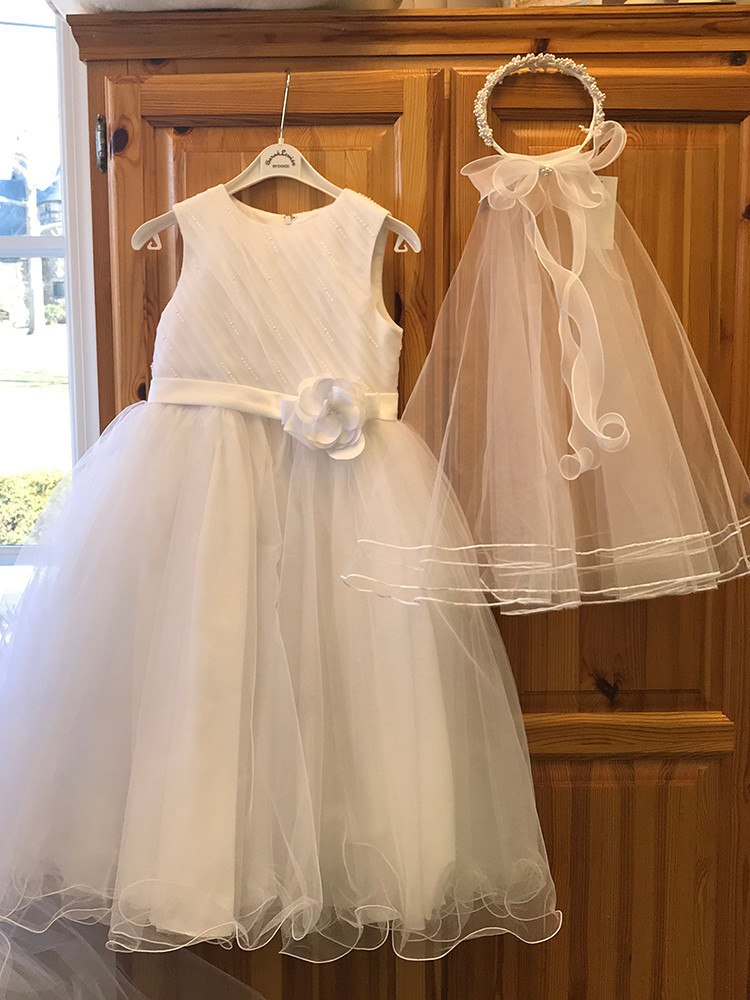 First communion dress, $180; veil, $65