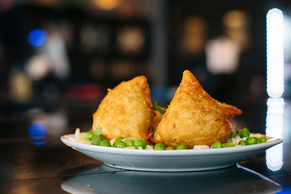 A few crispy vegetable samosas for starters