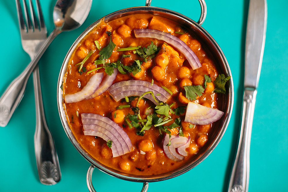 Aloo Chole combines chickpeas and potatoes in a steamy sauce