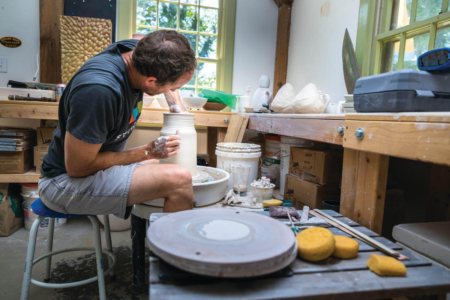 Charlie Barmonde of Arch Contemporary Ceramics creates his prolific works of pottery in his Tiverton studio.