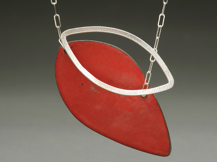 This red and silver necklace from artist Paulette Werger, made with flowing, organic shapes, sings holiday cheer while staying super on-trend. You'll be the red envy of the Yuletide ball with this elegant chain.