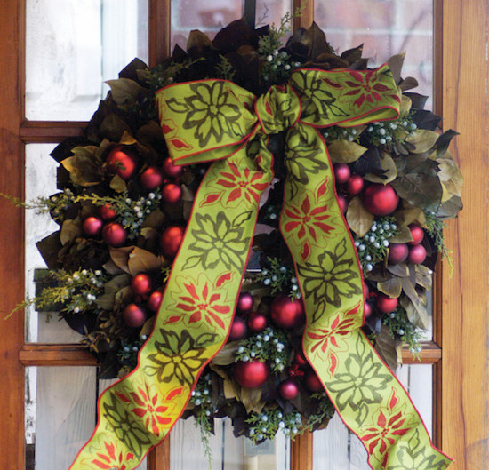 Preserved lemon leaf wreath with faux juniper, glass matte ornaments, and embroidered ribbon, $145