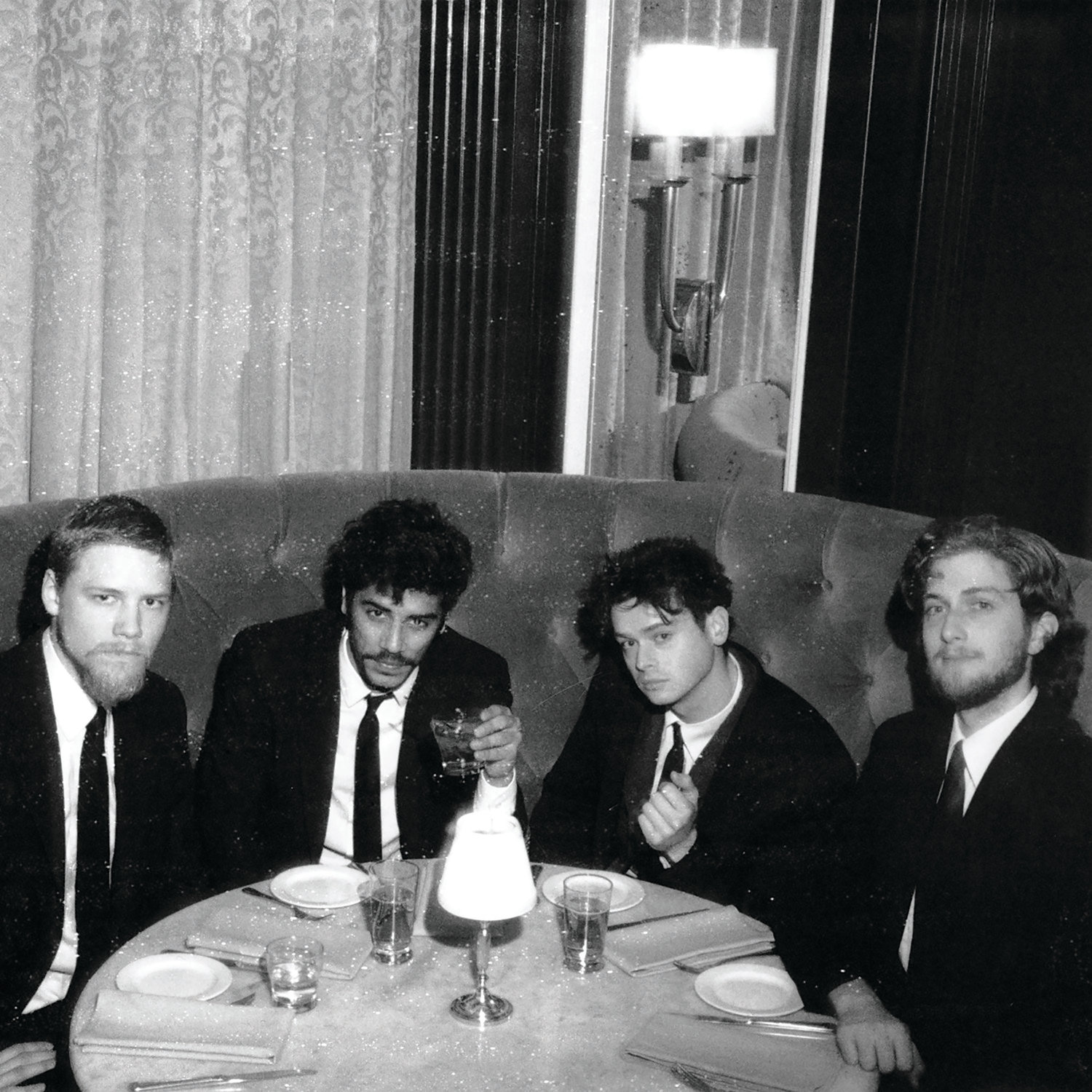 Left to right: Bryan Fielding, Rafay Rashid, Nick Politelli, and Ben Tucker of Ravi Shavi celebrate their new album Blackout Deluxe