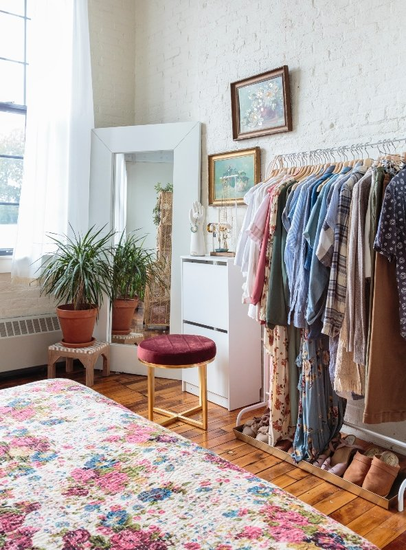A garment rack stands in for closet space