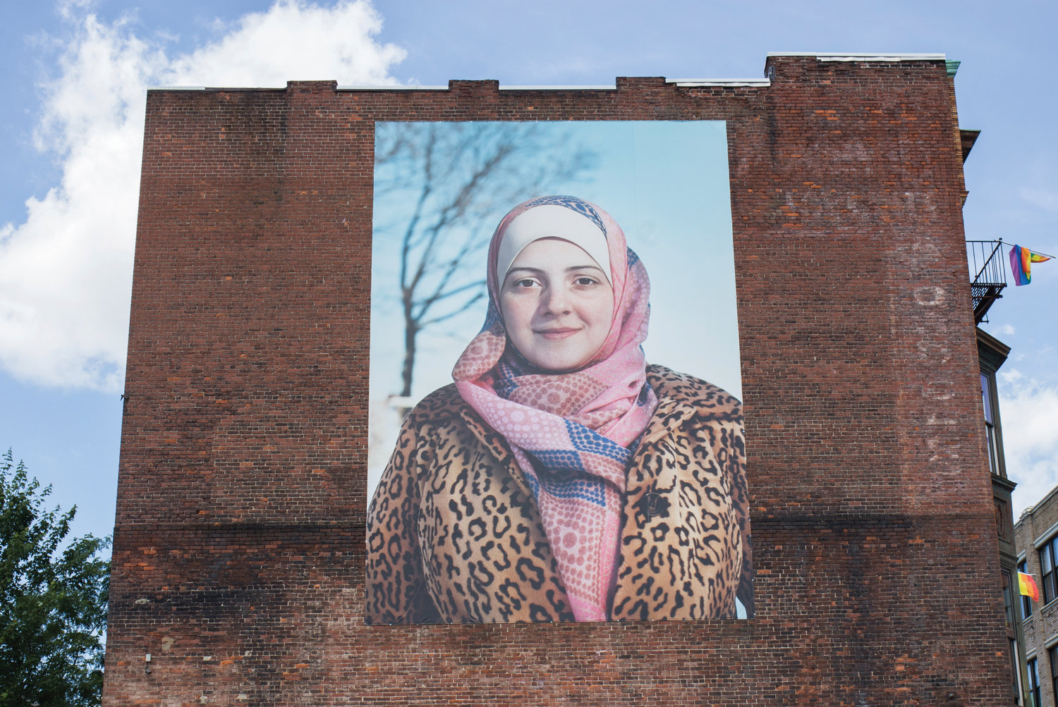 Initially, Bidur had reservations about putting her picture on this wall, fearing for the safety of her children and her family