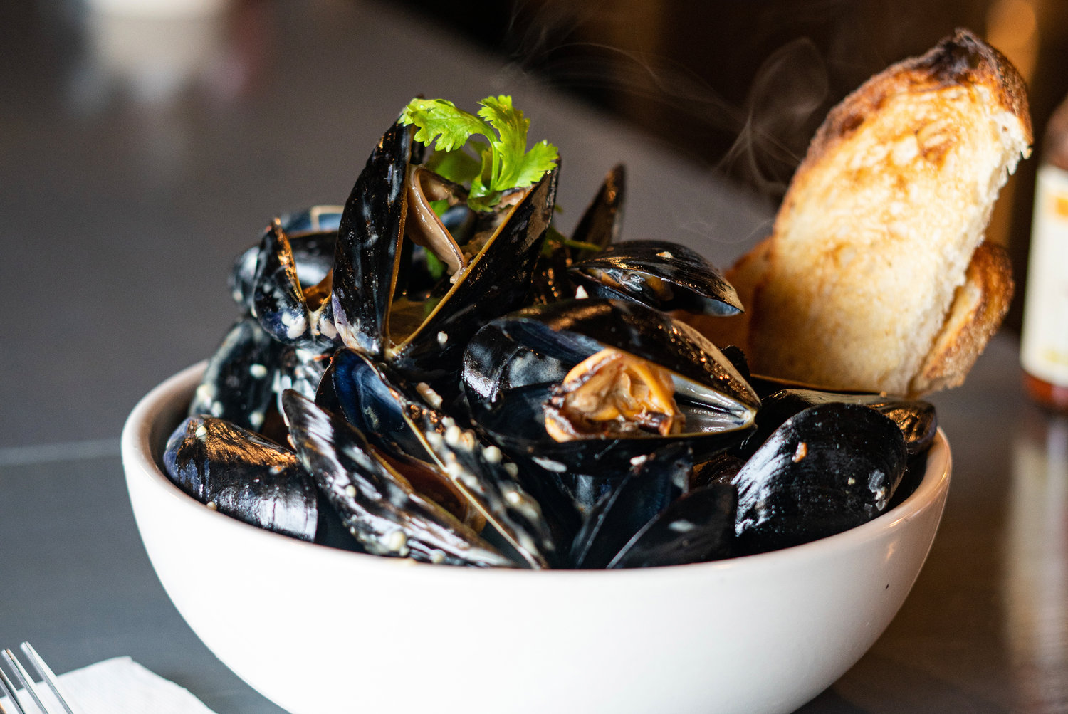 Local mussels served in a bath of Thai chili coconut milk at The Thirsty Gull