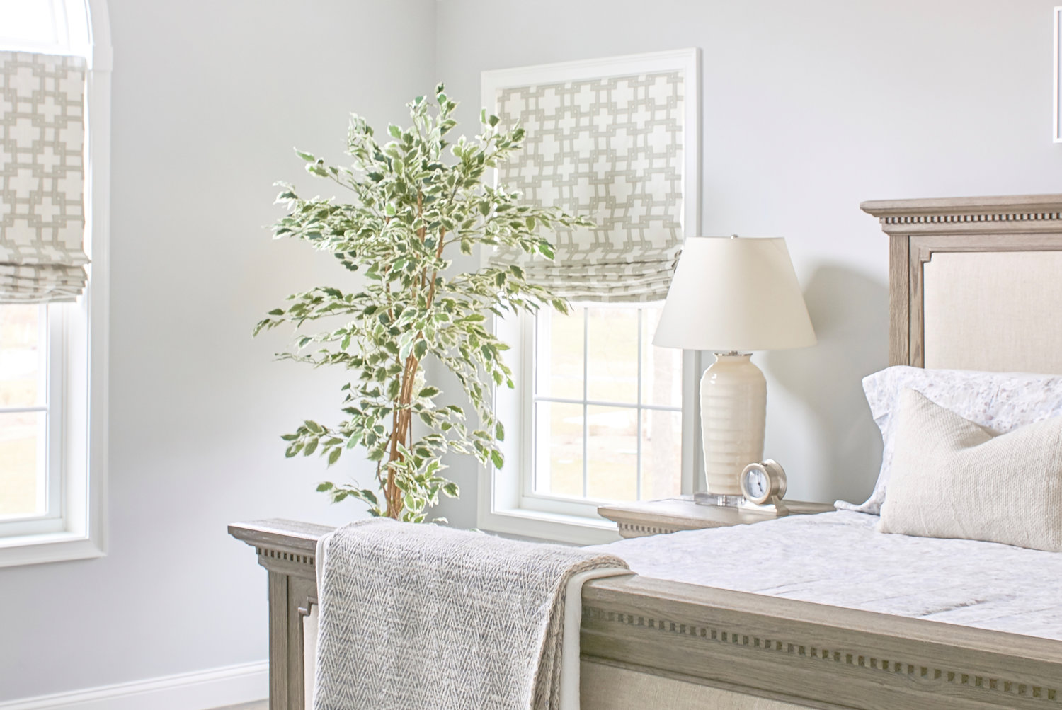 Linen shades with blue trim infuse the bright space with seaside 