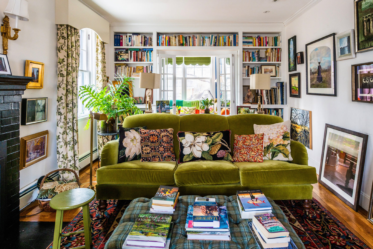 Books and plants are key elements throughout the home