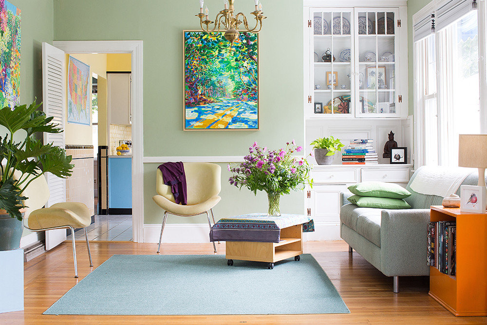 PULL COLOR FROM ART: Painter Margaret Owen draws a palette from her painting, which becomes a focal point in the sunny living room of her Providence bungalow.