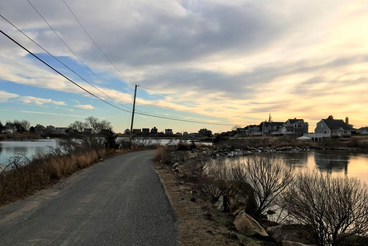 A causeway connects homes on Prospect Road to the rest of Matunuck