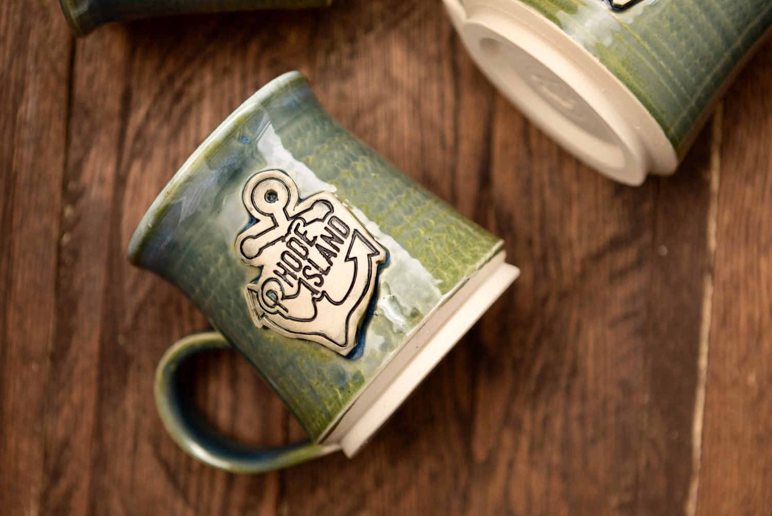 Handcrafted mugs show Rhody love