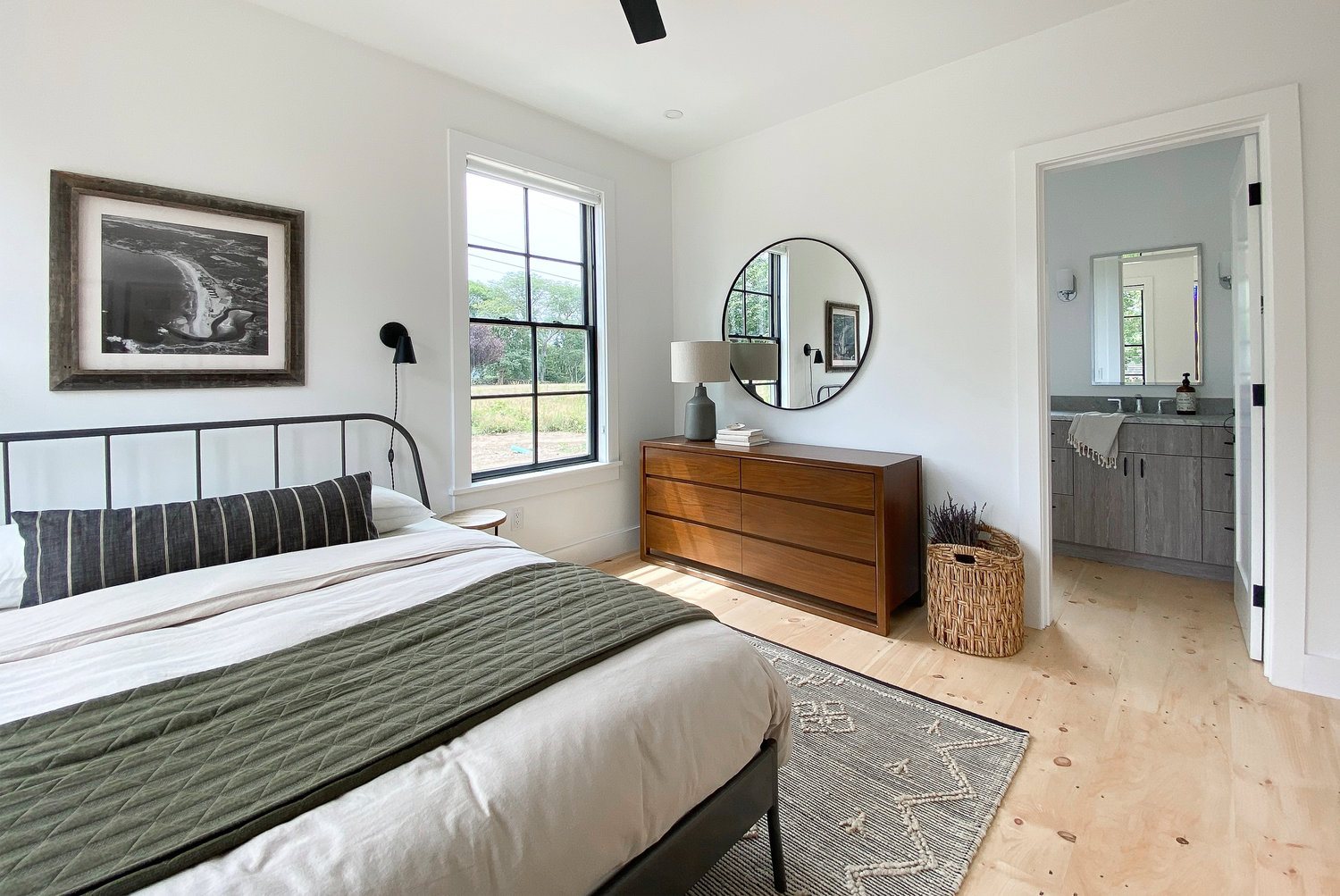 Modern design meets vintage farmhouse in the master bedroom