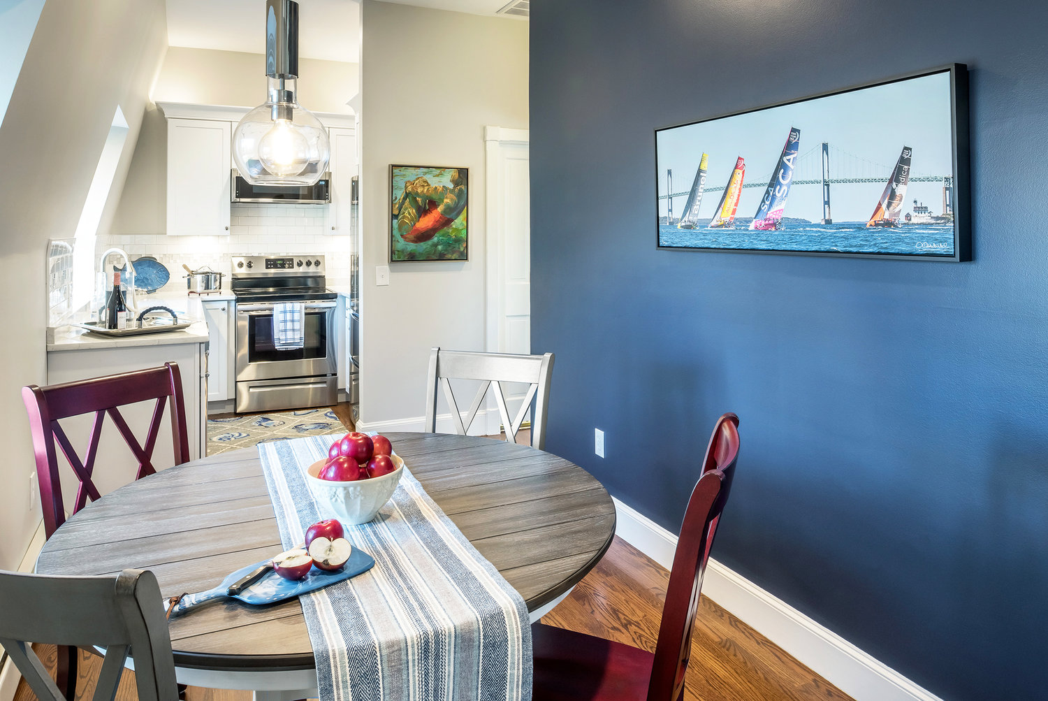Touches of deep blue add coastal cohesion from room to room