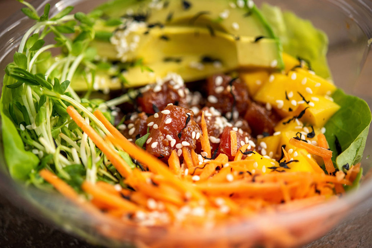 A Mango Avocado Bowl at Flat Waves features ahi tuna
