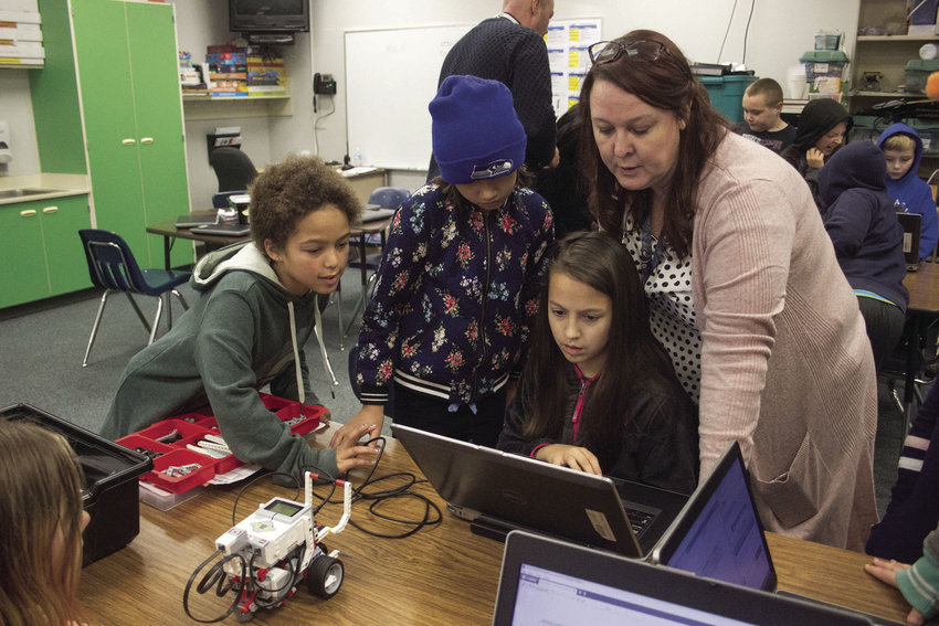 Chimacum Elementary fifth-graders Casey Taylor, Brooke Tomasetti and Olivia Lawson are guided through their hands-on robotics lessons by teacher Josette Mendoza.