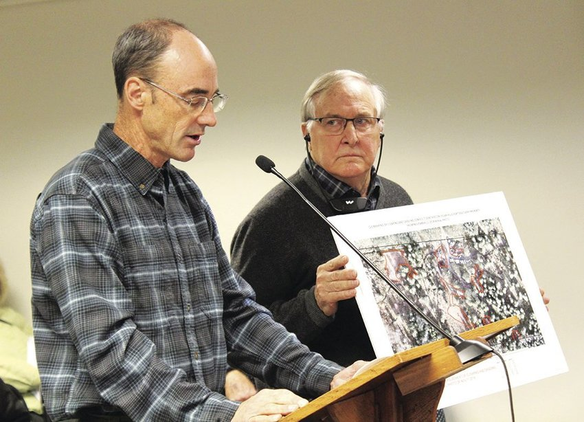 Peter Bahls, executive cirector of the Northwest Watershed Institute, explains his process in determining the possible code violations at the Cedar Hills Recreational Facility, while Tarboo Ridge Coalition Board President Peter Newland holds up a map to demonstrate to the Board of County Commissioners at their meeting Nov. 19.