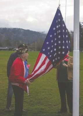 Quilcene Veterans of Foreign Wars Post 3213 Cmdr. Orville Fisk, Quartermaster Robert Alexander and Chaplain Robert Clubb raise the flag Nov. 9 on the new flagpole they helped install with Quilcene High School senior and Eagle Scout Olin Reynolds.