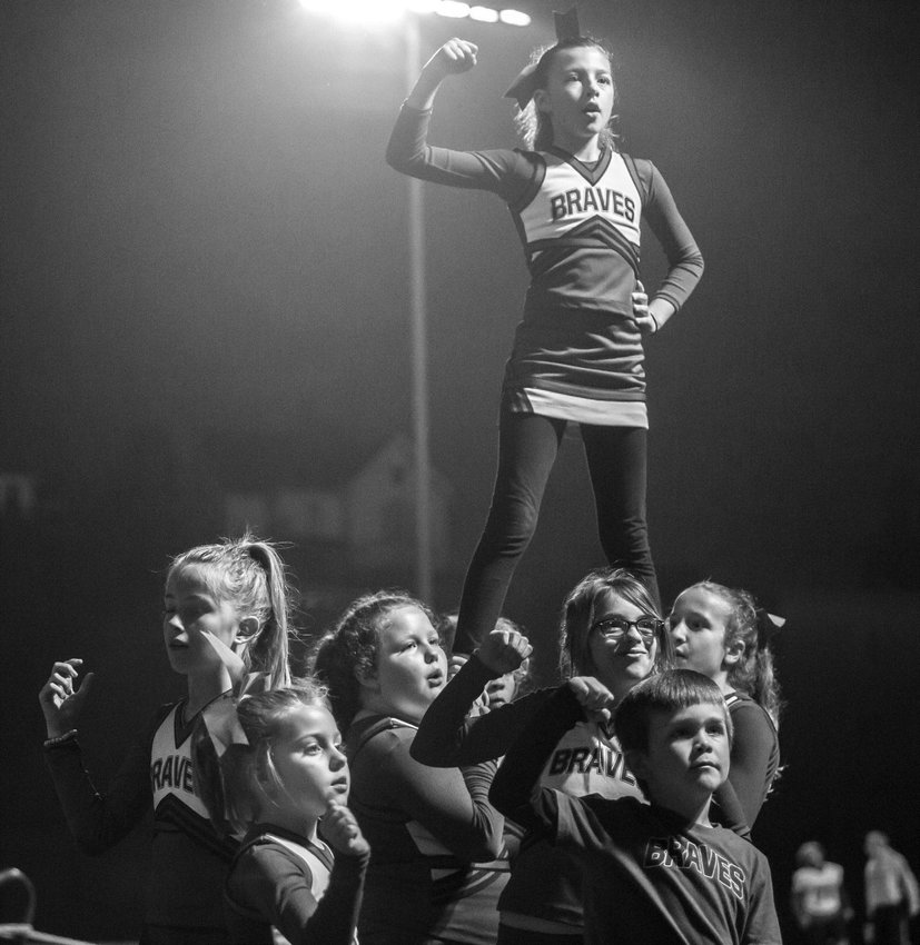 Braves little league cheerleaders pump up the crowd during the October 25 game against the Chimacum Cowboys.