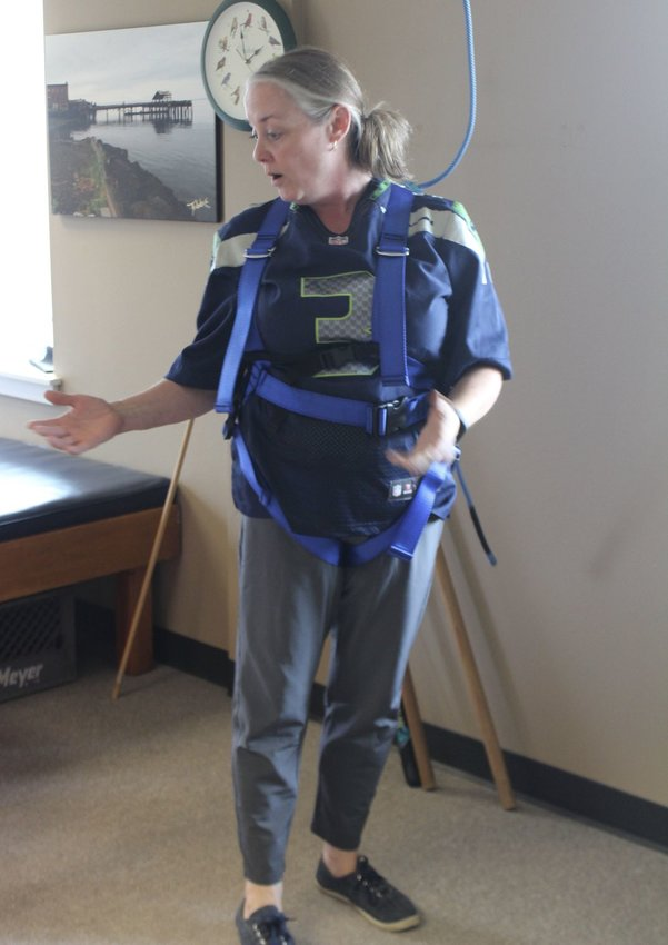 Barbara Arrowsmith, licensed physical therapist assistant at FYZICAL Therapy and Balance Center in Port Townsend, demonstrates how the balance equipment works. Leader photo by Lily Haight