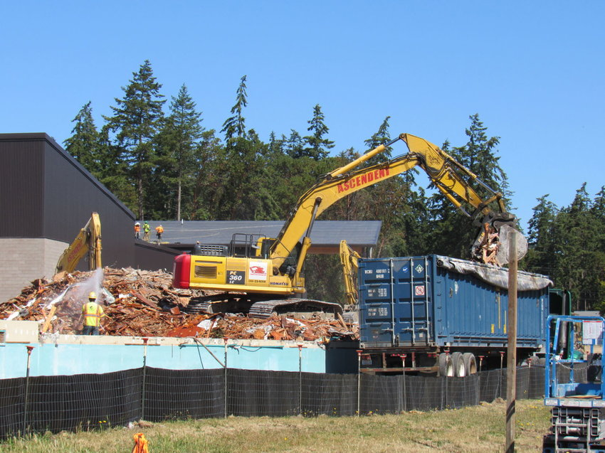 Demolition crews tear down the old Grant Street Elementary School to make more room for the new Salish Coast Elementary, which is due to open for the next school year.