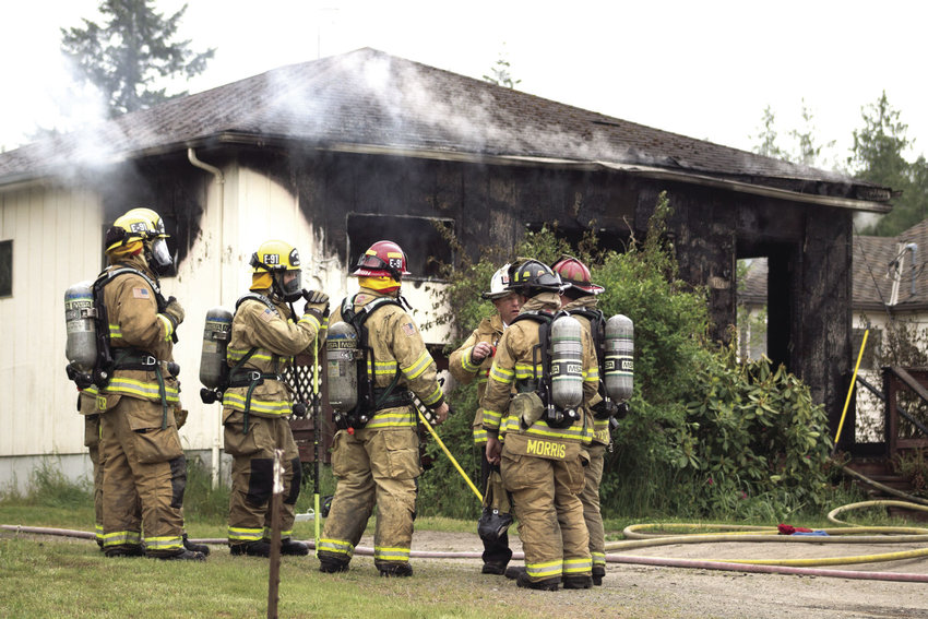 Firefighter have plan of attack after house fire outside of Port Townsend.