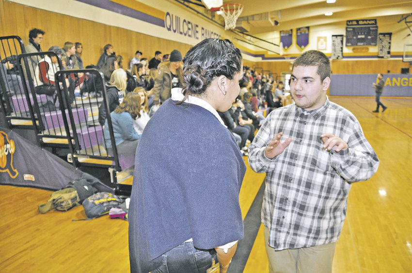 Rebecca Miles, great-niece of Billy Frank Jr., (left) speaks with Sean Dowd, Quilcene ASB vice president, after addressing the student body March 9. Photo by Viviann Kuehl