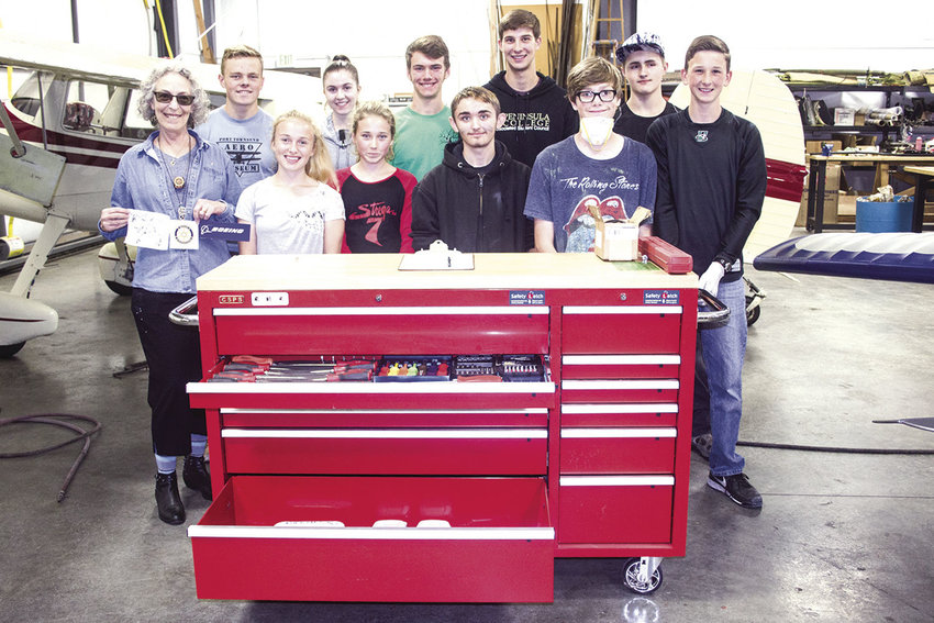 Port Townsend Rotarian and former Boeing engineer Jo Nieuwsma stands by STEM students, who now have a fully stocked tool chest to work with, at Jefferson County International Airport on Oct. 1. Photo by Kirk Boxleitner