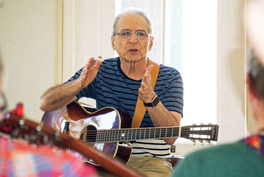 Happy Traum conducts a class in fingerpicking on the opening day of the Port Townsend Acoustic Blues Festival. Traum performs at the festival's Blues in the Clubs this weekend as well as Saturday's showcase at McCurdy Pavilion. Photo by Charlie Bermant