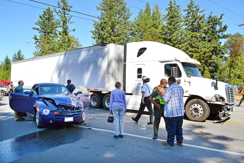 Rescue personnel work at the scene of a two-vehicle crash at the intersection of State Route 20 and South Discovery Road on Aug. 17. No one was injured when a driver pulled out in front of a semitruck loaded with paper rolls. The Washington State Patrol is investigating. Photo courtesy East Jefferson Fire Rescue