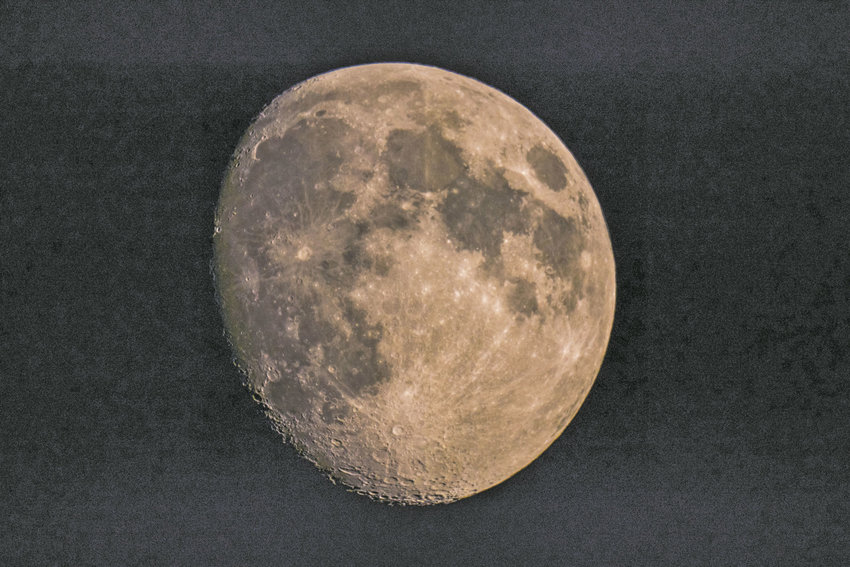 The moon glows pink from ash spewed into the atmosphere by wild fires on Vancouver Island and other parts of British Columbia. Temperatures rose into the 90s last week and are expected to be in the 70s and 80s this week. Smoke from the wildfires is expected to dissipate this week, with sunny skies predicted for the weekend, according to the National Weather Service. Photo by Steve Mullensky