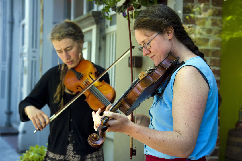 Channing Showalter and Annie Schermer busk on Water Street in downtown Port Townsend on Sunday, July 2. The musicians are participating in Centrum's Fiddle Tunes Workshop which is taking place through July 9. Photo by Katie Kowalski