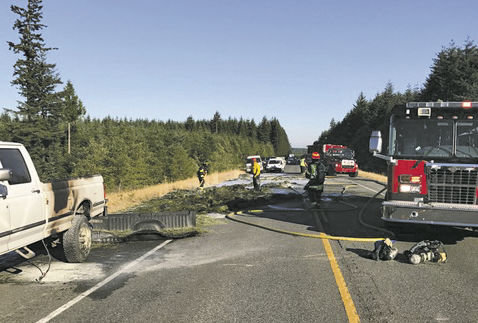 A truck carrying fire extinguishers stopped to help put out a fire on a truck carrying hay at 6:20 p.m., Monday, July 24 on East Sandy Shore Road. Firefighters appreciated the help. Photo courtesy Port Ludlow Fire and Rescue