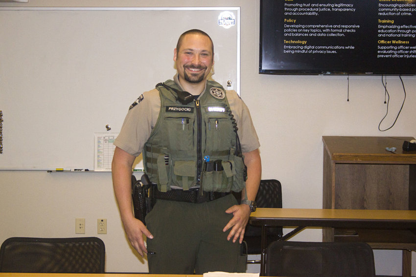 Jefferson County Sheriff's Deputy Brandon Przygocki models the utility vest design that's been approved by the department's uniform committee. Although the vest can be worn with deputies' jumpsuits, members of the Jefferson County Sheriff's Office Citizens Advisory Committee preferred the look of the vest with a khaki shirt and separate green uniform pants. Photo by Kirk Boxleitner