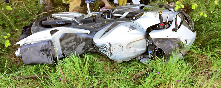 The man riding this motorcycle suffered multiple fractures and possibly internal injuries in an accident Monday, May 29 on South Jacob Miller Road. Courtesy photo East Jefferson County Fire Rescue