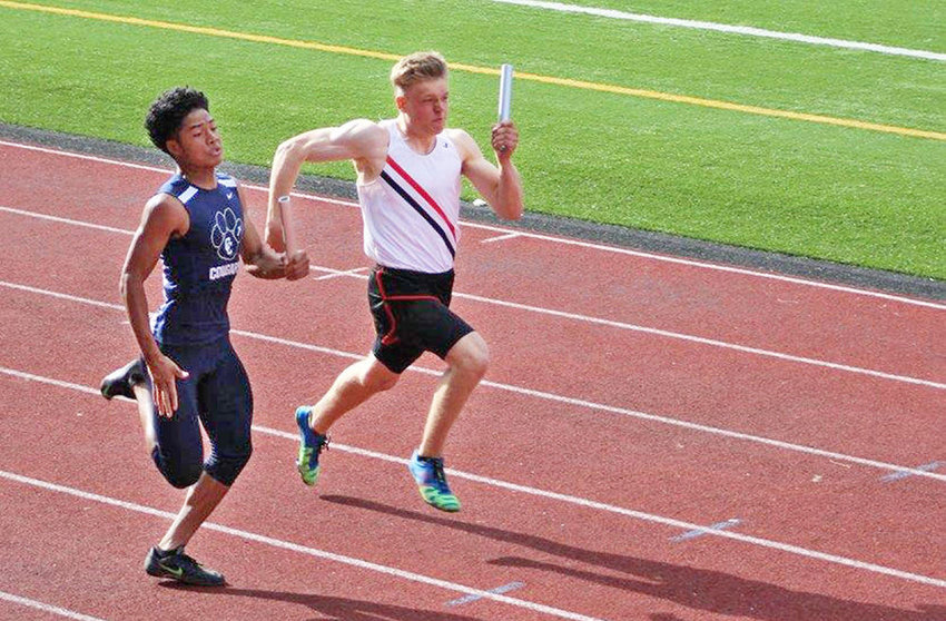 Erik Pokorny anchors the 4-x-100 meter relay in a tight finish.