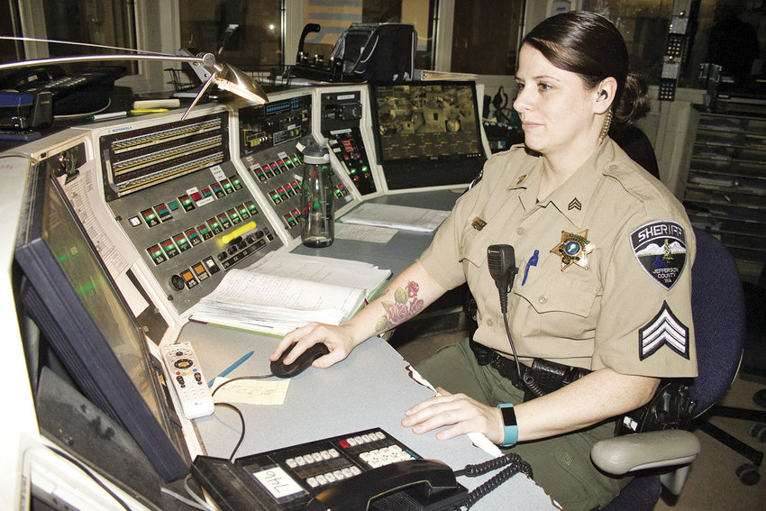 Jefferson County Corrections Sgt. Jennifer Cochran monitors the inmates of the Jefferson County Jail from the control room April 6. Photo by Kirk Boxleitner