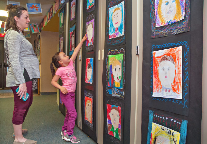 Sophia Borrayo, 6, points out some artwork to her mother, Jillian, during the annual Grant Street Elementary School art show on April 21. Photos by Chris Tucker