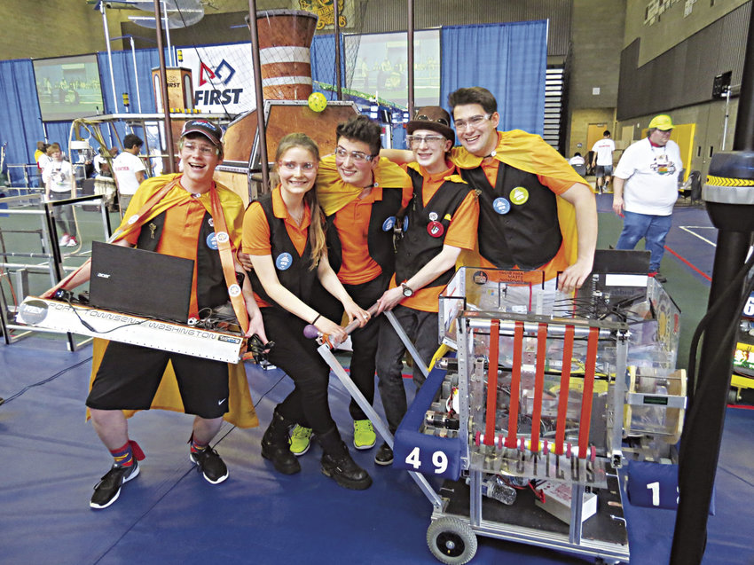 Members of the Port Townsend Roboctopi robotics team reveled in triumph after winning their April 1-2 match in Auburn. Pictured are (from left) driver Chance Kane, airship pilot Pallas Burhen, strategist Sam Jasper, operator Max Morningstar and programmer James Kienle. Photo courtesy of Pallas Burhen