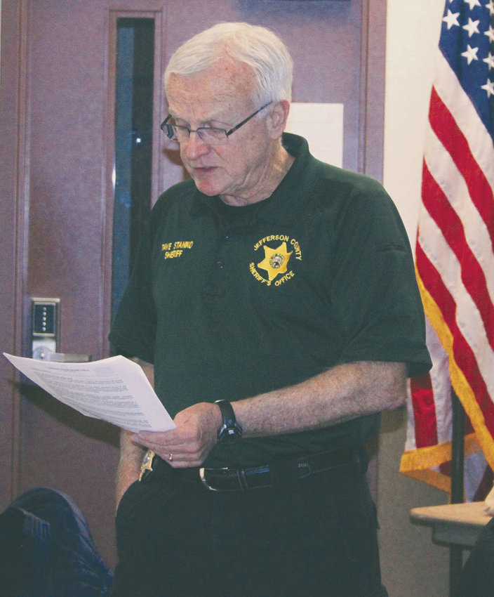 Jefferson County Sheriff Dave Stanko reads the Sheriff's Office Policy Manual's guidance on immigration violations to the Citizens Advisory Committee March 1. Photo by Kirk Boxleitner