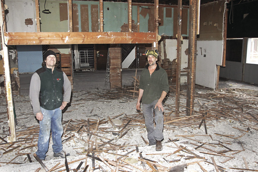 There are seven distinct bays in the former Surf restaurant on Port Townsend's waterfront, including this section, where Rod Hodlik (left) and Scott Nollette stand in what had been The Palms lounge (and later was a kitchen for Sea Galley and The Surf). Photo by Patrick Sullivan