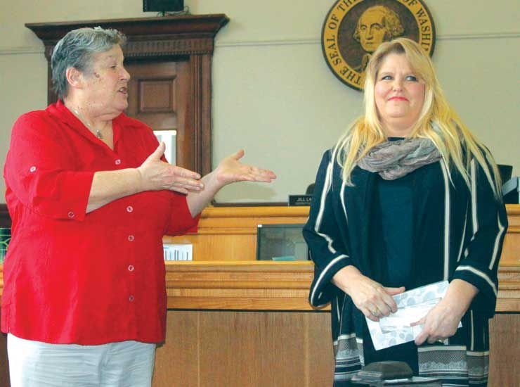 Jefferson County District Court Judge Jill Landes congratulates Corrina Lawhon-Wolfe for graduating from the Mental Health Therapeutic Court Feb. 28. Photo by Kirk Boxleitner